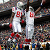 New England Patriots tight end Benjamin Watson (84) celebrates his second-quarter touchdown with Randy Moss (81) during an NFL football game against the Denver Broncos in Denver, Sunday, Oct. 11, 2009. (AP Photo/Jack Dempsey)