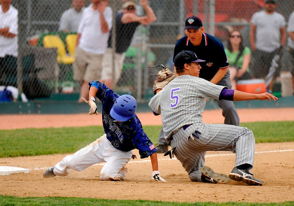 Broomfield's Jeff Fukushima, left, is tagged by Mountain View's Danny Netzel in the 9th inning at All City Stadium on Saturday. Mountain View won 4A championship game against Broomfield by 1-0 in 2nd extra inning. Hyoung Chang/ The Denver Post