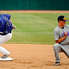 Broomfield's Dan Geubelle, left, doubles by Mountain View's short stop Brandon Baeckle at All City Stadium on Saturday. Mountain View won 4A championship game against Broomfield by 1-0 in 2nd extra inning. Hyoung Chang/ The Denver Post