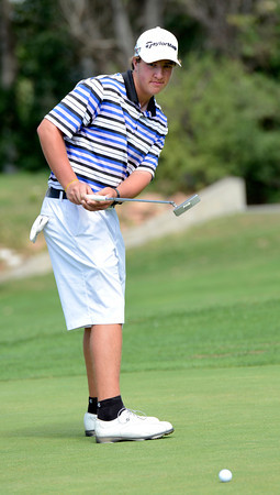 "Bridger Ryan watches a practice putt during a team qualifying round at the Eagle Trace Golf Club in Broomfield Colorado on Monday August 6. 2012.  For more photos go to  <a href=""http://www.bocopreps.com"">http://www.bocopreps.com</a>.<br /> Photo by Paul Aiken / The Daily Camera"