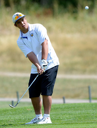 "Pat Lalancette chips onto the green during a team qualifying round at the Eagle Trace Golf Club in Broomfield Colorado on Monday August 6. 2012.  For more photos go to  <a href=""http://www.bocopreps.com"">http://www.bocopreps.com</a>.<br /> Photo by Paul Aiken / The Daily Camera"