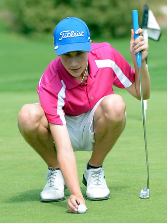 "Alex Gorman lines up a putt during a team qualifying round at the Eagle Trace Golf Club in Broomfield Colorado on Monday August 6. 2012.  For more photos go to  <a href=""http://www.bocopreps.com"">http://www.bocopreps.com</a>.<br /> Photo by Paul Aiken / The Daily Camera"