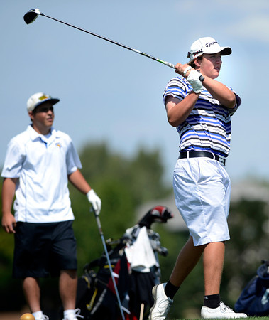 "Bridger Ryan tees off during a team qualifying round at the Eagle Trace Golf Club in Broomfield Colorado on Monday August 6. 2012.  For more photos go to  <a href=""http://www.bocopreps.com"">http://www.bocopreps.com</a>.<br /> Photo by Paul Aiken / The Daily Camera"