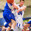 S0208LONGMONT5.jpg S0208LONGMONT5<br /> Broomfield's #0, Dan Perse and Longmont's #24, Reily Mau get tied up under the hoop during their game at Longmont High School on Tuesday evening February 7th, 2012.<br /> <br /> Photo by: Jonathan Castner