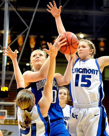 Broomfield High School senior Bre Burgesser pushes through Longmont defenders as she drives to the hoop during the Colorado High School Athletic Association girls class 4A championship game on Friday, March 11, at the Coors Events Center on the University of Colorado campus in Boulder. Broomfield defeated Longmont 48-38.<br /> Jeremy Papasso/ Camera