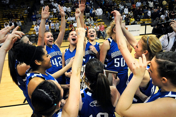 Broomfield High School players celebrate after winning the Colorado High School Athletic Association girls class 4A championship game on Friday, March 11, at the Coors Events Center on the University of Colorado campus in Boulder. Broomfield defeated Longmont 48-38.<br /> Jeremy Papasso/ Camera