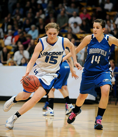 20110311_BKOL_BROOMFIELD_HADDOCK_NEHF_1.JPG Longmont's Tambre Haddock drives the lane around Broomfield's Katie Nehf in the Class 4A Championship game at Coors Events Center in Boulder on Friday, March 11, 2011. (Joshua Buck/Times-Call)