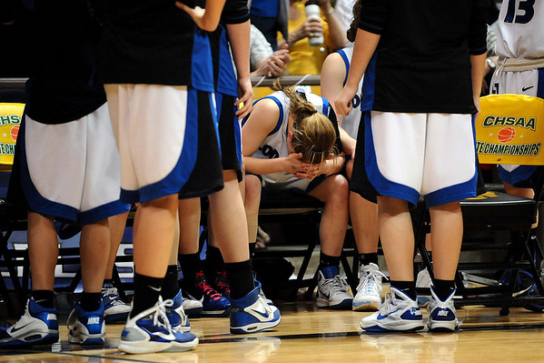 20110311_BKOL_BROOMFIELD_THORNHOLT_1.JPG Longmont's Amber Thornholt reacts to missing a free throw late in regulation,  which would've sealed the game against Broomfield in the Class 4A Championship game at Coors Events Center in Boulder on Friday, March 11, 2011. The Trojans went on to lose in overtime 48-38. (Joshua Buck/Times-Call)
