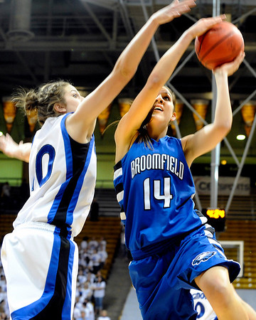 Broomfield High School senior Katie Nehf drives past Longmont's Erica Meier during the Colorado High School Athletic Association girls class 4A championship game on Friday, March 11, at the Coors Events Center on the University of Colorado campus in Boulder. Broomfield defeated Longmont 48-38.<br /> Jeremy Papasso/ Camera