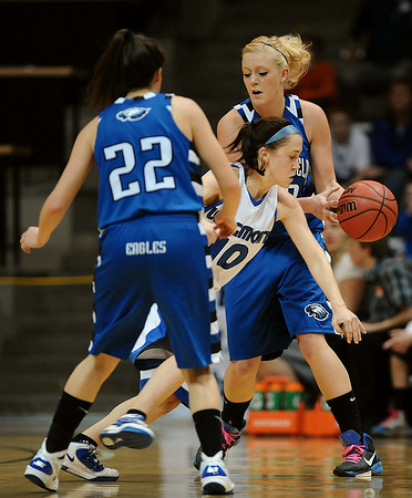 20110311_BKOL_BROOMFIELD_MEIER_BURGESSER_ZEC.JPG Longmont's Erica Meier forces a turnover between Broomfield's Brittney Zec (22) and Bre Burgesser in the Class 4A Championship game at Coors Events Center in Boulder on Friday, March 11, 2011. (Joshua Buck/Times-Call)