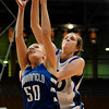 20110311_BKOL_BROOMFIELD_CARPENTER_BURGESSER_1.JPG Longmont's Megan Carpenter knocks a rebound out of the hands of Broomfield's Bre Burgesser in the Class 4A Championship game at Coors Events Center in Boulder on Friday, March 11, 2011. (Joshua Buck/Times-Call)
