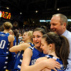 Broomfield High School players Brittney Zec, left center, hugs teammate Bri Wilber, right center, and Head Coach Mike Croell after winning the Colorado High School Athletic Association girls class 4A championship game on Friday, March 11, at the Coors Events Center on the University of Colorado campus in Boulder. Broomfield defeated Longmont 48-38.<br /> Jeremy Papasso/ Camera
