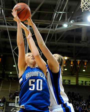 Broomfield High School senior Bre Burgesser gets her shot rejected by a Longmont defender during the Colorado High School Athletic Association girls class 4A championship game on Friday, March 11, at the Coors Events Center on the University of Colorado campus in Boulder. Broomfield defeated Longmont 48-38.<br /> Jeremy Papasso/ Camera