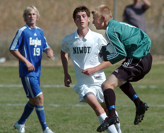 Broomfield's Brendan Buchanan, right, catches a shot by  Niwot during Saturday's game at Niwot High.<br /> <br /> October 3, 2009<br /> Staff photo/David R. Jennings
