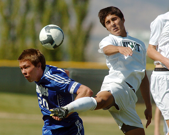 Garrett Seitz, left, Broomfield, fights for the ball with Santiago Velez, Niwot during Saturday's game at Niwot High.<br /> <br /> October 3, 2009<br /> Staff photo/David R. Jennings