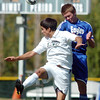 Garrett Seitz, right, Broomfield, and Santiago Velez, Niwot, go up for a header during Saturday's game at Niwot High.<br /> <br /> October 3, 2009<br /> Staff photo/David R. Jennings