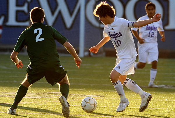 Broomfield's Landon Roos, 10, keeps possession of the ball against Niwot's Nick Terry, 2, during the semi-finals of the class 4A state soccer championships at Englewood High School in Englewood, Saturday, Nov. 7,  2009. <br /> KASIA BROUSSALIAN / THE CAMERA