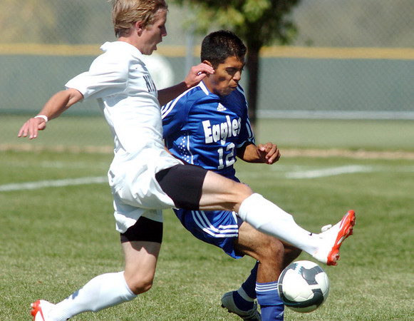 Carlos Ruiz, right, Broomfield, and  Dan Summers, Niwot, go for the ball during Saturday's game at Niwot High.<br /> <br /> October 3, 2009<br /> Staff photo/David R. Jennings