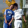 Landon Roos, left, Broomfield,  goes up for a header with Curtis Stecyk, Niwot during Saturday's game at Niwot High.<br /> <br /> October 3, 2009<br /> Staff photo/David R. Jennings