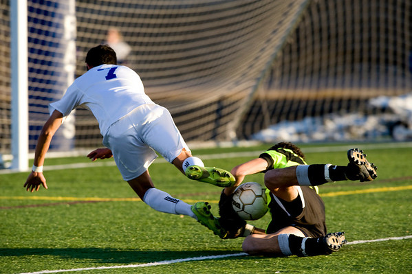 Broomfield's Carlos Mendez, 7, trips over  Niwot's goal keeper Connor Wood (1) during the semi-finals of the class 4A state soccer championships at Englewood High School in Englewood, Saturday, Nov. 7,  2009. <br /> KASIA BROUSSALIAN / THE CAMERA