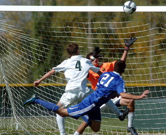 Broomfield's Cole Chapleski, right, watches as the ball go past  Niwot's goalie Connor Wood and Michele Corbet to score a goal during Saturday's game at Niwot High.<br /> <br /> October 3, 2009<br /> Staff photo/David R. Jennings