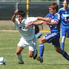 Niwot's Santiago Velez, left, fights for control of the ball with Garrett Seitz, Broomfield, during Saturday's game at Niwot High.<br /> <br /> October 3, 2009<br /> Staff photo/David R. Jennings