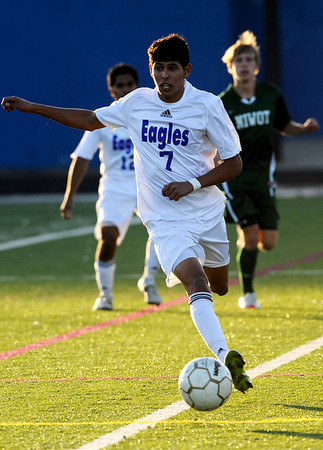 Broomfield's Carlos Mendez, 7, dribbles down field while playing against Niwot during the semi-finals of the class 4A state soccer championships at Englewood High School in Englewood, Saturday, Nov. 7,  2009. <br /> KASIA BROUSSALIAN / THE CAMERA