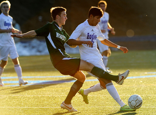 Broomfield's Carlos Mendez, 7, dribbles ahead of Niwot's Michele Corbet, 4, during the semi-finals of the class 4A state soccer championships at Englewood High School in Englewood, Saturday, Nov. 7,  2009. <br /> KASIA BROUSSALIAN / THE CAMERA