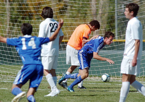 Broomfield's Cole Chapleski, right, reacts after scoring a goal  Niwot's goalie Connor Wood to score a goal during Saturday's game at Niwot High.<br /> <br /> October 3, 2009<br /> Staff photo/David R. Jennings