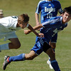 Alex Tagawa, right, Broomfield, and Tyler Terry, Niwot, collide during Saturday's game at Niwot High.<br /> <br /> October 3, 2009<br /> Staff photo/David R. Jennings