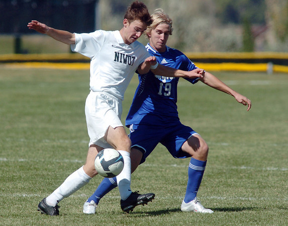 Michele Corbet, left, Niwot,  fights for control of the ball with Will Roberts, Broomfield, during Saturday's game at Niwot High.<br /> <br /> October 3, 2009<br /> Staff photo/David R. Jennings