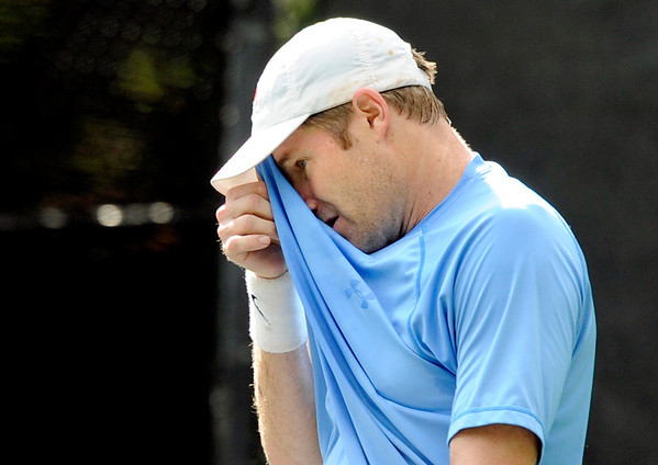 """Willie Dann, of Denver, wipes sweat from his forehead while playing in the men's singles championship tennis match against Richard Johnson, of Boulder, on Sunday, Aug. 14, during the Babolat Boulder Open at the Millennium Harvest House in Boulder. Johnson won the match. For more photos of the men's and women's singles championship go to  <a href=""""http://www.dailycamera.com"""">http://www.dailycamera.com</a><br /> Jeremy Papasso/ Camera"""