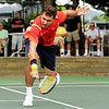"Richard Johnson, of Boulder, stretches out to hit the ball while playing in the men's singles championship tennis match against Willie Dann, of Denver, on Sunday, Aug. 14, during the Babolat Boulder Open at the Millennium Harvest House in Boulder. Johnson won the match. For more photos of the men's and women's singles championship go to  <a href=""http://www.dailycamera.com"">http://www.dailycamera.com</a><br /> Jeremy Papasso/ Camera"