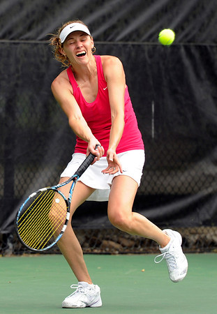 """Yana Ruegsegger, strains to get to the ball while playing in the women's singles championship tennis match against Vasilisa Bardina on Sunday, Aug. 14, during the Babolat Boulder Open at the Millennium Harvest House in Boulder. Bardina won the match. For more photos of the men's and women's singles championship go to  <a href=""""http://www.dailycamera.com"""">http://www.dailycamera.com</a><br /> Jeremy Papasso/ Camera"""