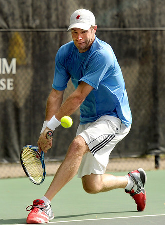 "Willie Dann, of Denver, hits a low flying ball while playing in the men's singles championship tennis match against Richard Johnson, of Boulder, on Sunday, Aug. 14, during the Babolat Boulder Open at the Millennium Harvest House in Boulder. Johnson won the match. For more photos of the men's and women's singles championship go to  <a href=""http://www.dailycamera.com"">http://www.dailycamera.com</a><br /> Jeremy Papasso/ Camera"