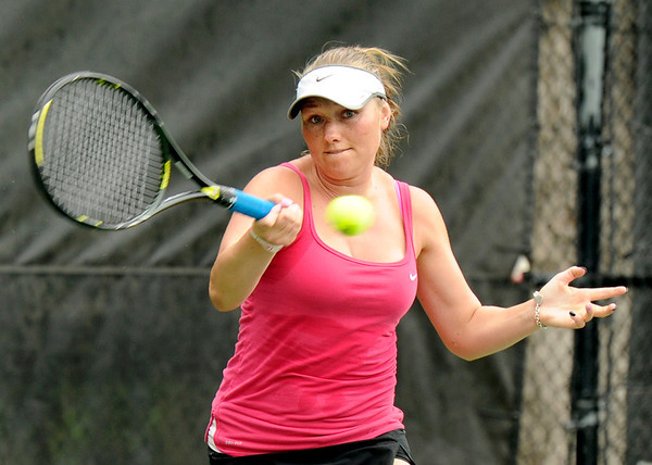 "Vasilisa Bardina hits the ball while playing in the women's singles championship tennis match against Yana Ruegsegger on Sunday, Aug. 14, during the Babolat Boulder Open at the Millennium Harvest House in Boulder. Bardina won the match. For more photos of the men's and women's singles championship go to  <a href=""http://www.dailycamera.com"">http://www.dailycamera.com</a><br /> Jeremy Papasso/ Camera"