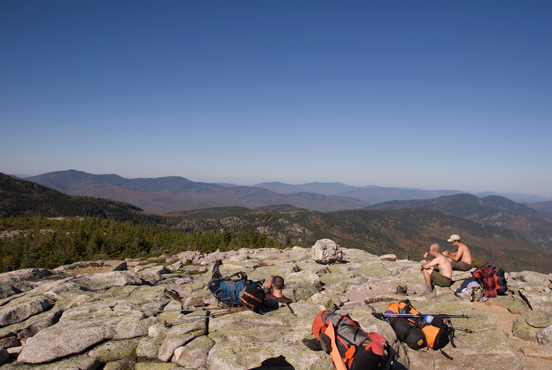 the crew snacking at the summit and enjoying the autumn views