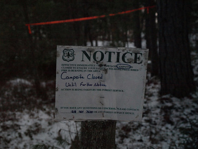 The USFS appears to have a habit of putting signs up when they are needed ..... and subsequently ommitting to remove them after the danger has passed.  Forgoing and leaving cell phone in the car, we were unable to find out more about the raging fire and moved on.