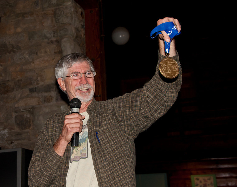 Aldhawest2010-5390-Edit-2<br /> Scout holding up his PCTA completion medallions. Erik Ryback, the first PCT thru-hiker (early '70's) was the originator of the idea of giving Olympic quality medals to those who have completed the PCT.