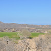 Hole 10, par 3.  Stripes in the hills in the distance are roads for the housing development that hasn't yet started.
