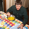 "Paul is tackling a complex task of selecting finest ingredients for ""White Fruit Cake,"" a recipe for less than optimal health.  The recipe starts with one cup of sugar, followed by one cup of melted butter, and it goes down hill from there.  After eating this 1,000 calories per slice the cake I will need to make an appointment with my health guidance coach, and with my company dietician both."
