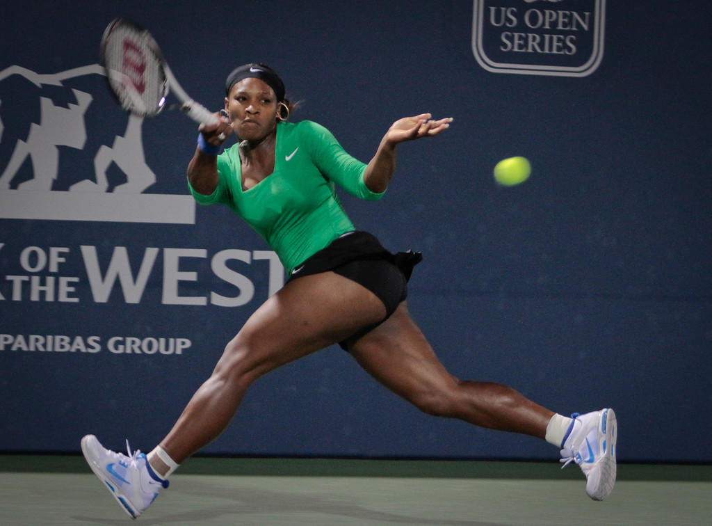Serena Williams hits a forehand in her match against Maria Sharapova at the Bank of the West Classic in Stanford, Calif., on Friday, July 29th, 2011.