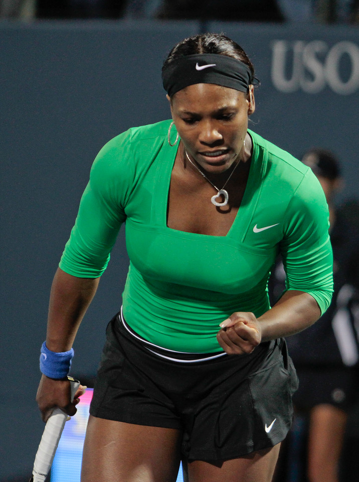 Serena Williams reacts to a winning shot in her match against Maria Sharapova at the Bank of the West Classic in Stanford, Calif., on Friday, July 29th, 2011.