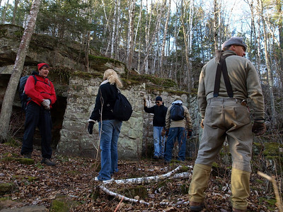 Hikers examine the site.
