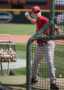 Head Coach Dave Van Horn pitches batting practice during preparations for the 2015 Fayetteville Super Regional championship.  (Alan Jamison, Nate Allen Sports Service)