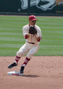 Rick Nomura turns a double play during a game last season.  (Alan Jamison, Nate Allen Sports Service)