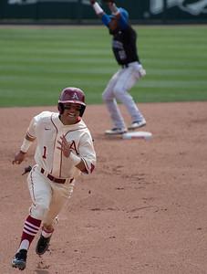 Rick Nomura runs for third base during a game last season.  (Alan Jamison, Nate Allen Sports Service)