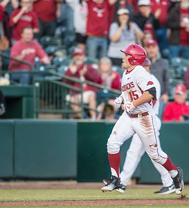 Arkansas outfielder Jake Arledge (15) runs home during a baseball game between Arkansas and Central Michigan on 2-19-16.   (Alan Jamison, Nate Allen Sports Service)