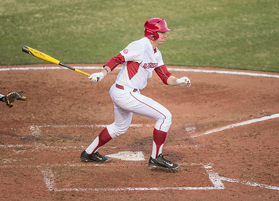 Arkansas outfielder Austin Catron (19) heads to first base during a baseball game between Arkansas and Central Michigan on 2-19-16.   (Alan Jamison, Nate Allen Sports Service)