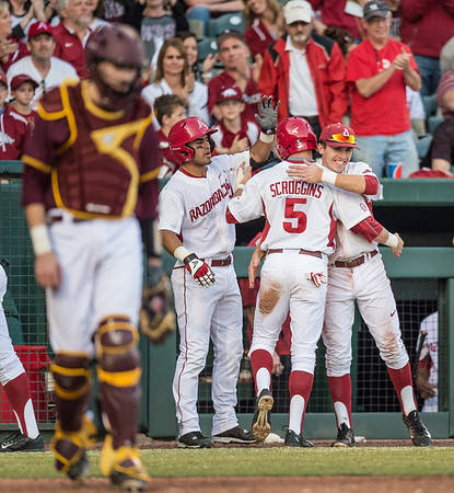 Arkansas infielder Cody Scroggins (5) celebrates his first run with Arkansas infielder Michael Bernal (3) and Arkansas catcher Carson Shaddy (20) during a baseball game between Arkansas and Central Michigan on 2-19-16.   (Alan Jamison, Nate Allen Sports Service)